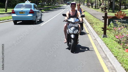 People driving on mopeds on street