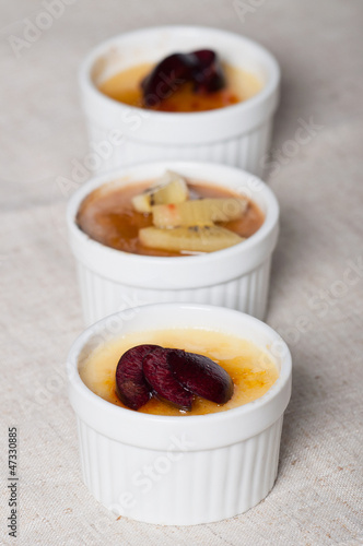creme brulee with fresh slice fruits on top