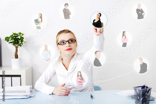 Businesswoman choosing the right worker.