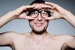 Funny portrait of a man with glasses, binoculars concept