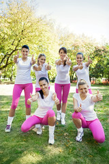 Group of sporty women with thumbs up
