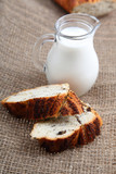Glass jug with milk and bread