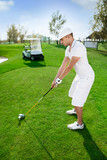 Golfer is preparing to hit golf ball