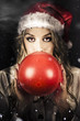 Young Christmas Girl Blowing Up Party Balloon