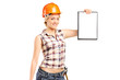 Afemale manual worker wearing helmet and holding a clipboard