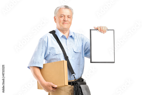 A delivery person holding a clipboard and box