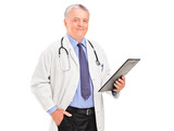 A mature doctor holding a clipboard
