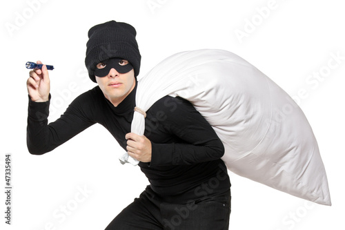 A robber with a bag on his back and flashlight