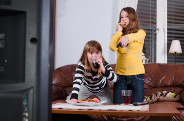 Girls eating sweets in front of tv