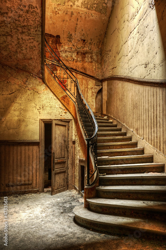 Decaying staircase in an abandoned central office|47335613