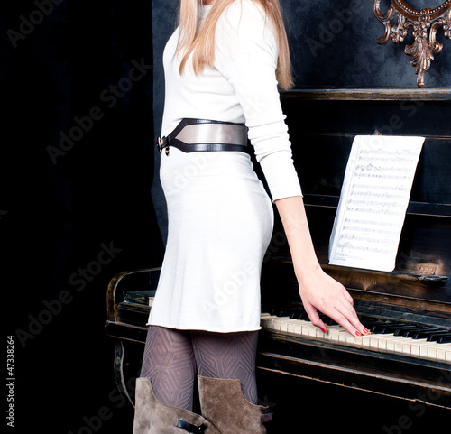 young woman and piano