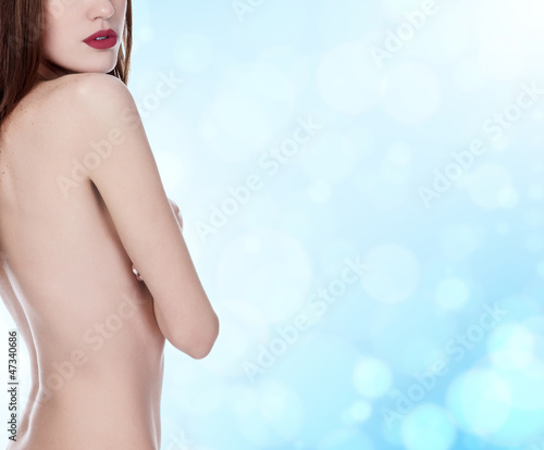 beautiful woman with long hair on blue blurred background