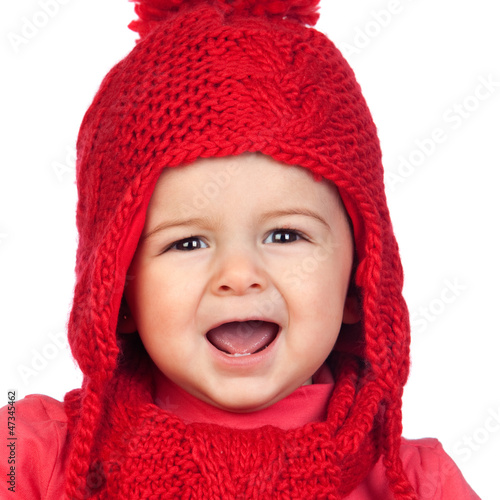 Baby girl with a funny wool red hat