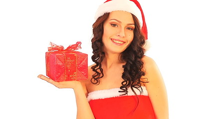 Woman in Santa hat holding red gift box.