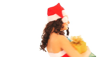 Happy woman in Santa hat holding stack gift box.