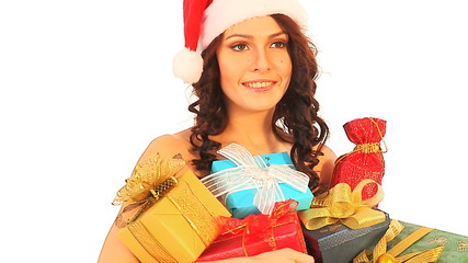 Woman in Santa hat holding stack gift box.