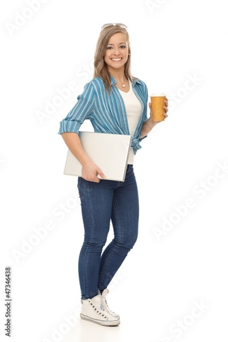 Full size young woman with laptop and coffee
