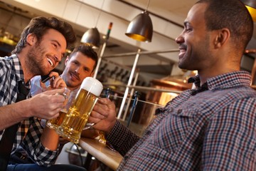 Friends drinking in pub