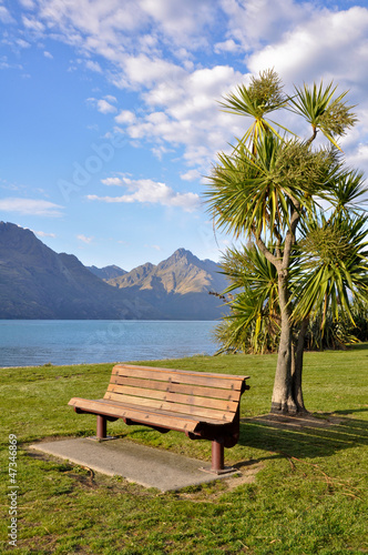 Wooden bench on side of Lake Wakatipu, Queenstown, New Zealand
