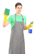 A smiling male cleaner holding cleaning equipment