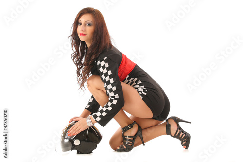 beautiful young woman in a racing suit and helmet