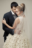 gentle couple of lovers groom and bride. studio shooting at whit