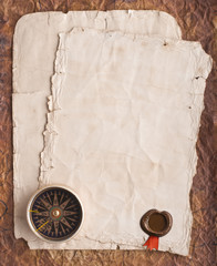 old compass on grunge background with a wax seal and ribbon