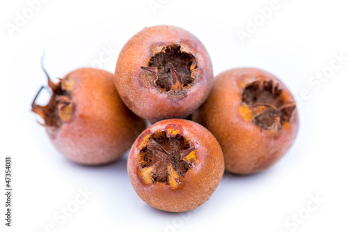 Healthy Medlars isolated on white background