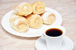 Pastry rolls with cream and coffee