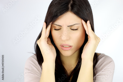 Beautiful woman with terrible headache