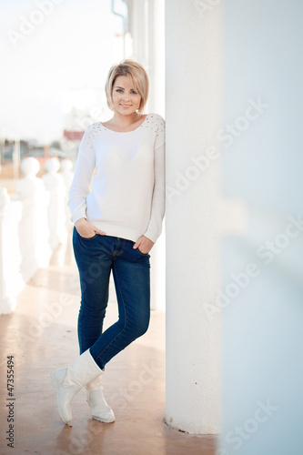 Full length portrait of fashion young blond woman