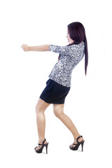 Businesswoman with skirt pull with strength on copyspace