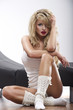 Beautiful blonde woman sitting