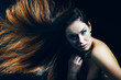 Portrait of a beautiful woman with a blowing hair