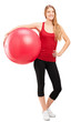 Young female athlete holding a pilates ball