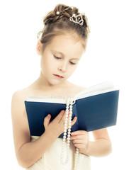 Pretty beautiful girl with a prayer book.