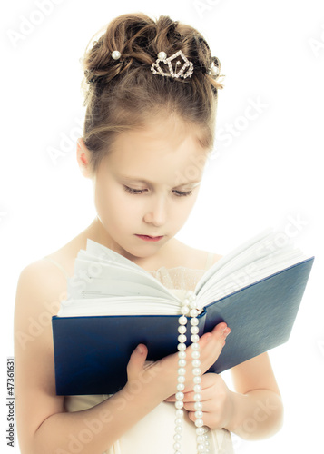 Pretty beautiful girl with a prayer book.