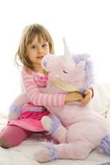 Little girl hugs mascot