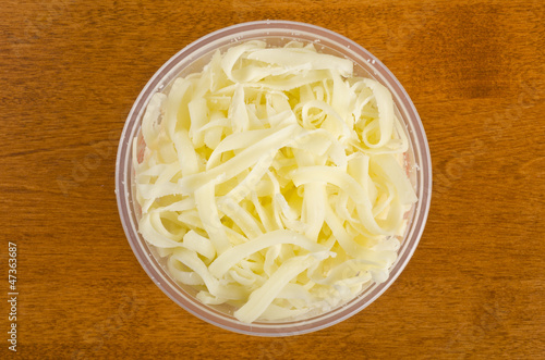 Shredded Mozzarella Cheese in a Plastic Container