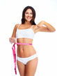 Beautiful healthy woman with a measuring tape.