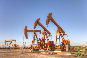 oil pump jacks under blue sky. (HDR)