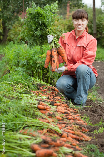 woman with carrot harvest