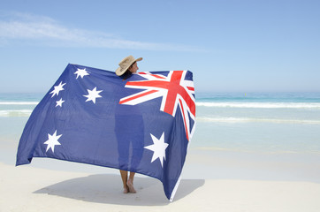 Attractive woman Australian flag at ocean beach