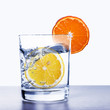 Glass of water with lemon and orange