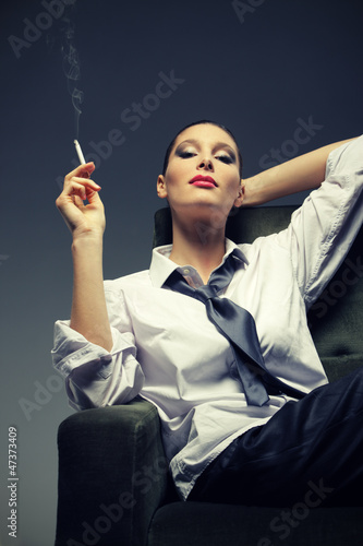 Sensual woman smoking a cigarette