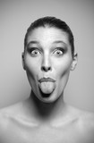 Young woman pokes out her tongue poster