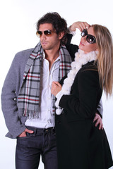 Couple of fashion models with sunglasses