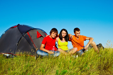 Teenagers beside a tent