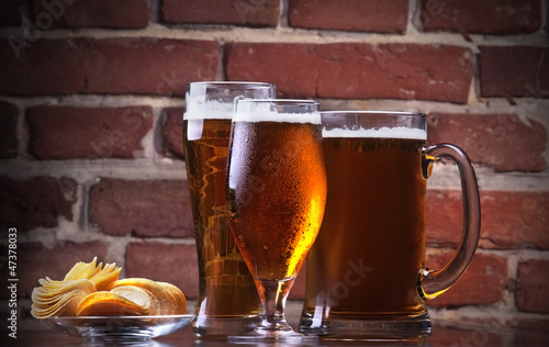 glass of Fresh Beer and plate with chips