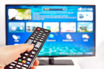 Smart tv and  hand pressing remote control